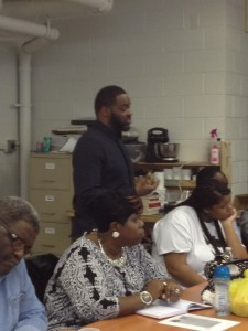 Mr. Tobias speaks to families about scholarships which help pay for college.
